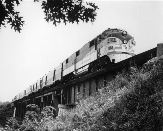 Chesapeake and Ohio's Pere Marquette en route through the Michigan countryside on its run to Detroit, crossing Thornapple Bridge, circa 1958.