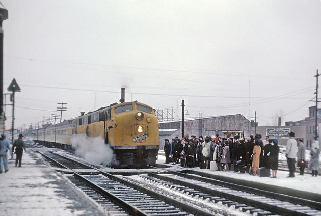 C&NW EMD E7A No. 5015A with the Kate Shelly 400 in DeKalb, Illinois on December 28, 1964.