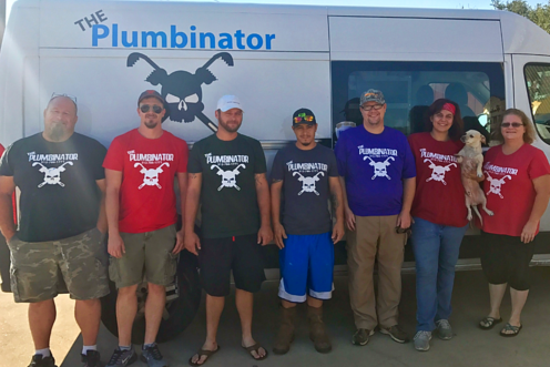 Photo of The Plumbinator staff - 7 people wearing logo T-shirts, 2 female and 5 male