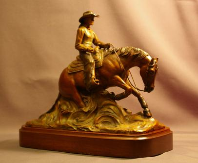 Reining horse bronze with woman rider