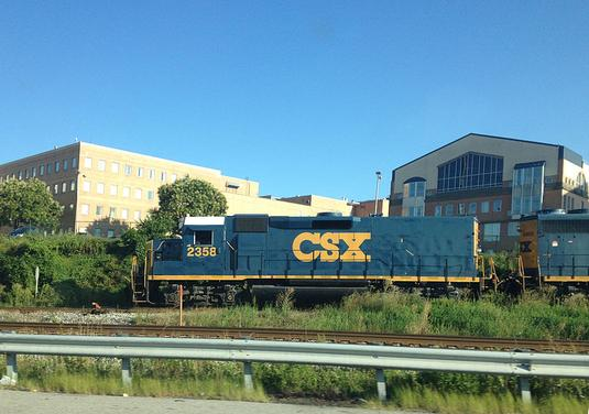 CSX ex-EMD GP40 road slug 2358 in Chester, Pennsylvania. Note the lack of radiator openings and fans, compared to the trailing unit.