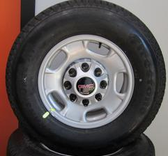 "17"" CHEVY OR GMC 8 LUG steel wheels and firestone tires"