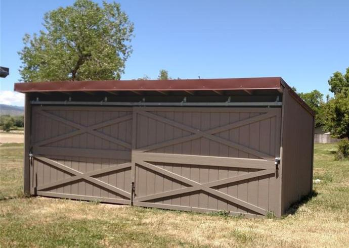 Storage shed with sliding doors