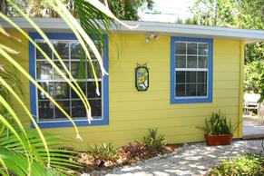 Fern Have studio with yellow exterior and blue windows.