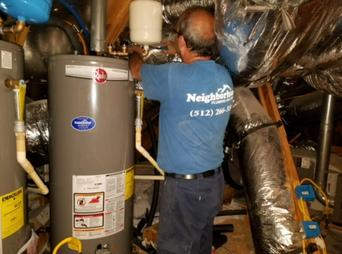 Plumber installing gas water heater in Bee Cave, Texas