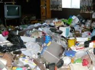 picture of a hoarding mess in a home.