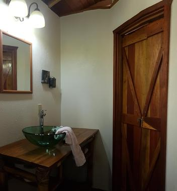 Hand-crafted hardwood doors in the Bamboo Bungalow at Leaning Palm Resort.