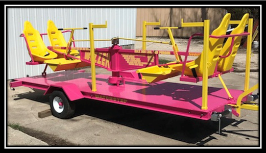 pink and yellow Wizzer carnival ride for sale
