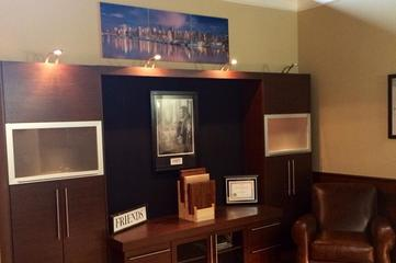 Wall units and entertainment cabinets by Complete Cabinet Works