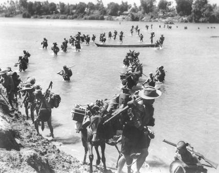 Gurkhas crossing the River Irrawaddy in central Burma during WW2