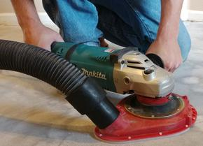 Dust free tile removal sander grinding down the thinset beneath the flooring