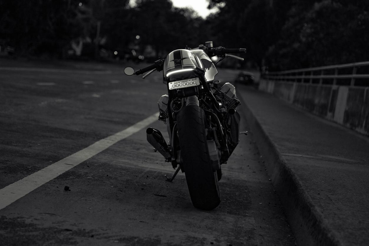 moto guzzi cafe racer at dawn black and white