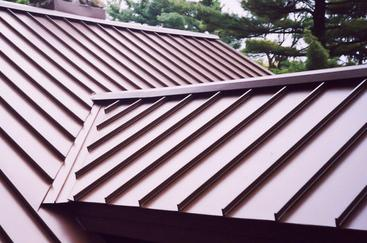 Standing seam metal roof installation; red standing seam metal roof system; metal roof installation in Houston; Houston roof contractor