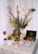 Hot and cold beverages, just-baked cookies, hard candies and fruit are available throughout the day. Table in front parlor with fruit, candies, flowers