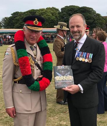 HRH Prince Charles with Craig Lawrence at the Regimental Launch of the new Gurkha RGR25 book