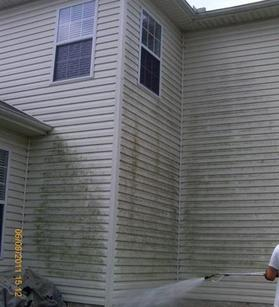 A two story mold, mildew, dirt, and grime covered house before the Soft Washing by A1 Pressure Washing