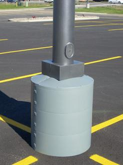 Light pole base protector covers rusty or crumbly cement bases.
