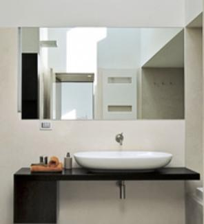 Photo of custom framless mirror in bathroom