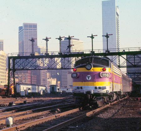 A commuter rail train at South Station in 1981, led by EMD FP10 locomotive No. 1150.