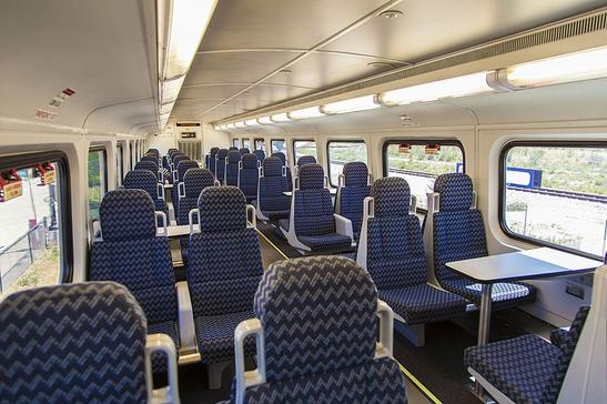 The interior of a Utah Transit Authority FrontRunner Bombardier BiLevel coach.