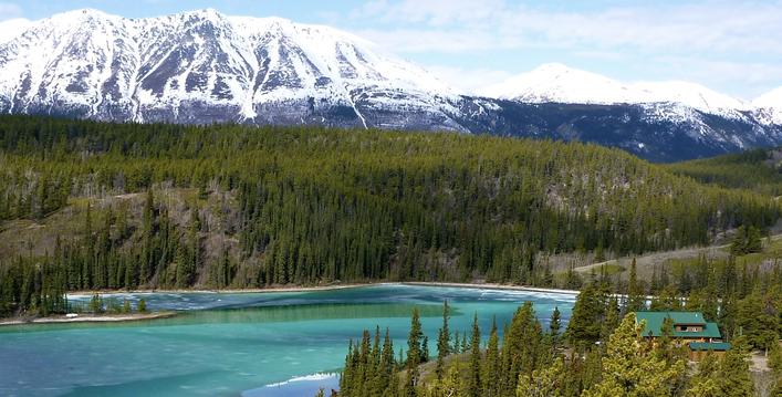 Lovely green Emerald Lake lies 75 miles north of Skagway, Alaska in the Yukon Territory of Canada.