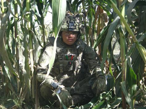 A Gurkha soldier taking a break on patrol in Afghanistan