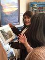 Texas artist Lindy Cook Severns visits with a collector in Alpine, Texas