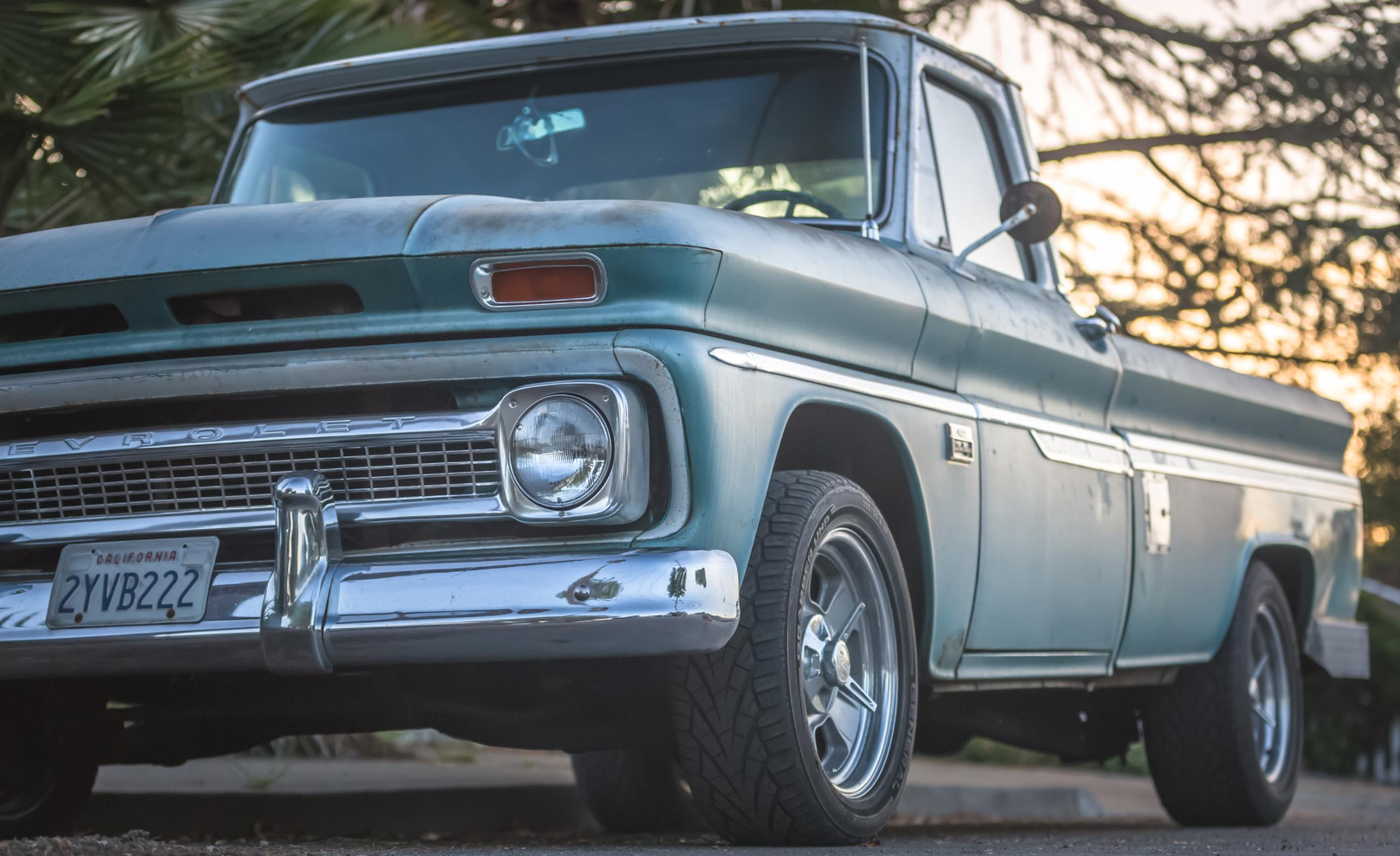 vintage chevy truck green and chrome sunset