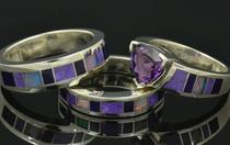 Sugilite and opal engagement and wedding ring set.