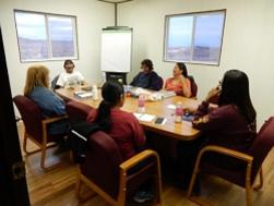 a group meets in the new Hopi School building