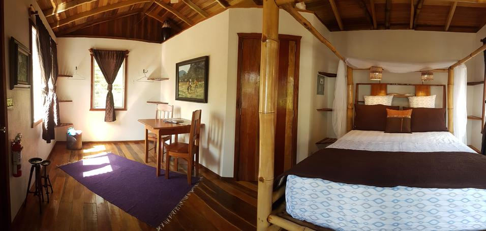The interior of the Bamboo Bungalow at Leaning Palm Resort in Belize.
