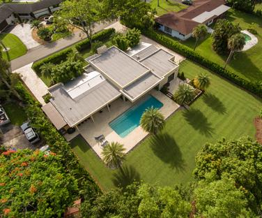 Aerial Shot of Custom Built Home with Backyard and Pool