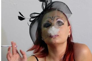 women blowing smoke