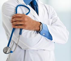 doctor in white coat holding a stethoscope