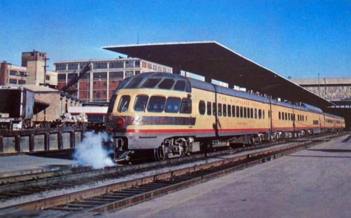 A Skytop observation/lounge car that ran on the Hiawatha named trains of the Chicago, Milwaukee, and St. Paul Railroad. These cars went into service in 1948, and were painted in the Union Pacific color scheme in 1955. Pictured is the Priest Rapids car, No. 189, at the Milwaukee depot in Milwaukee in 1968.
