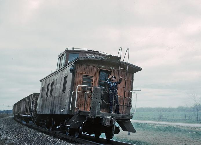 A Texas and New Orleans RR caboose on eastbound local No. 86 near LaCoste, TX in 1960. Photo by Roger Puta.