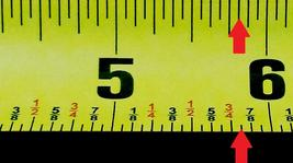 Measuring tape with arrow pointing to five and thirteen sixteenths