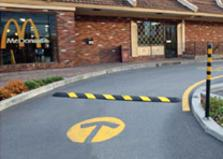 Plastic speed bump controls speed in a drive-thru