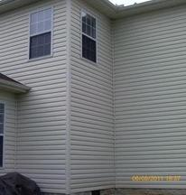 A house that was covered in dirt, grime, mold and mildew after A1 Pressure Washing cleaned it using the soft wash method.