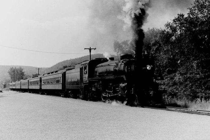 "Canadian Pacific ""G5c"" Class 4-6-2 No.1246 ""F. Nelson Blount"" blasts out of Bellows Falls with a Green Mountain R.R. enthusiasts' train, at Steamtown, Bellows Falls, Vermont 8/70."
