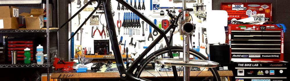 Black bike frame in the stand waiting to built to customer specifications