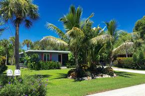 Blue Lagoon Bungalow on Palm Island, the heart of Siesta Key. This vacation rental has a large,tropical yard.