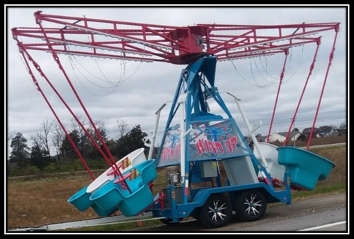wind up carnival ride in transport mode