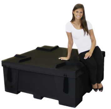 Girl sitting on OFC freight case.