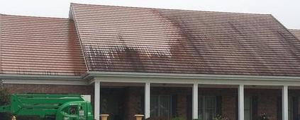 Roof soft washing method being performed by A1 Pressure Washing