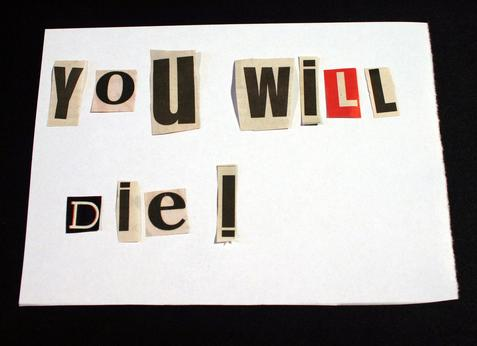 Death threat pieced together with letters from magzine and glued on a piece of paper spelling 'you will die'