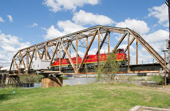 A PTRA train in 2016, crossing one of two surviving swing bridges over Buffalo Bayou in Houston.