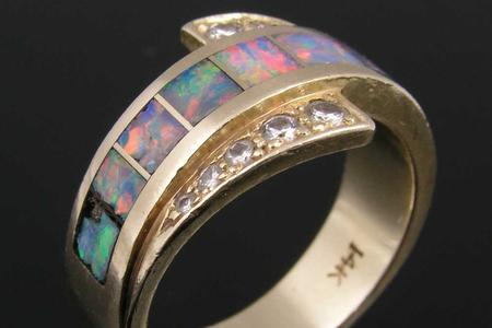 Diamond and opal inlay ring that needs repairs.