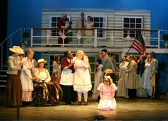 Cast and ensemble on stage