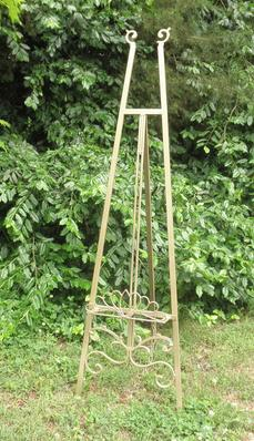 "Gold vintage easel, 56"" inches tall for rent at Rent Your Event, LLC. Great for holding chalkboards or bridal portraits."